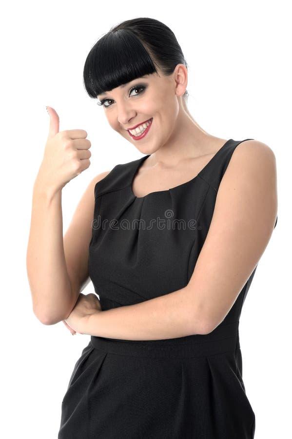 Femme gaie heureuse positive avec des pouces souriant  image libre de droits