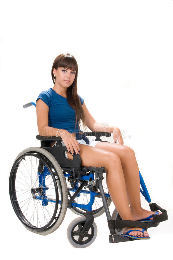 Femme handicapé sur le fauteuil roulant images libres de droits