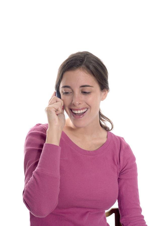 Femme heureuse au téléphone image stock