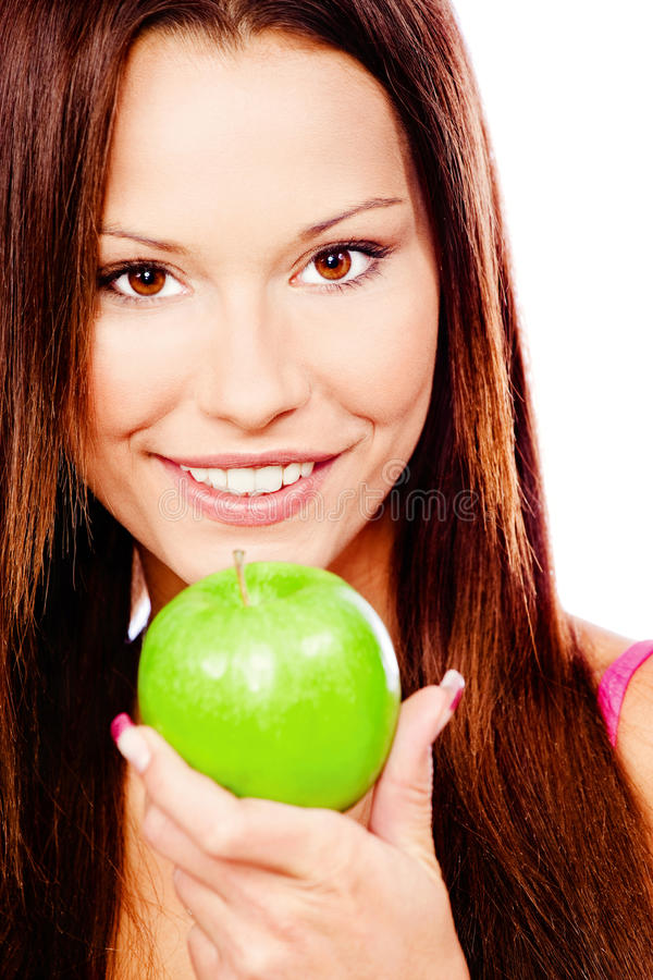 Femme heureuse avec la pomme verte image stock
