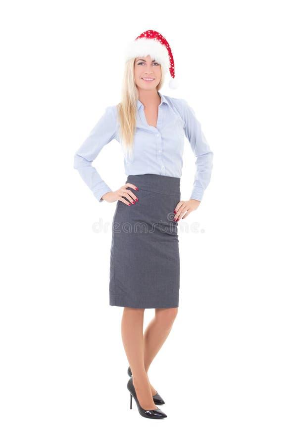 Femme heureuse d'affaires dans la pose de chapeau de Santa d'isolement sur le blanc image libre de droits