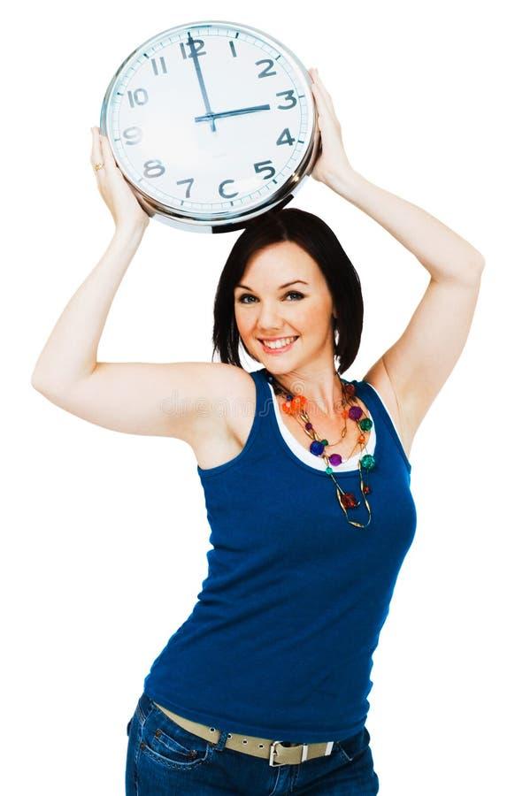 femme heureuse de fixation d'horloge photo libre de droits