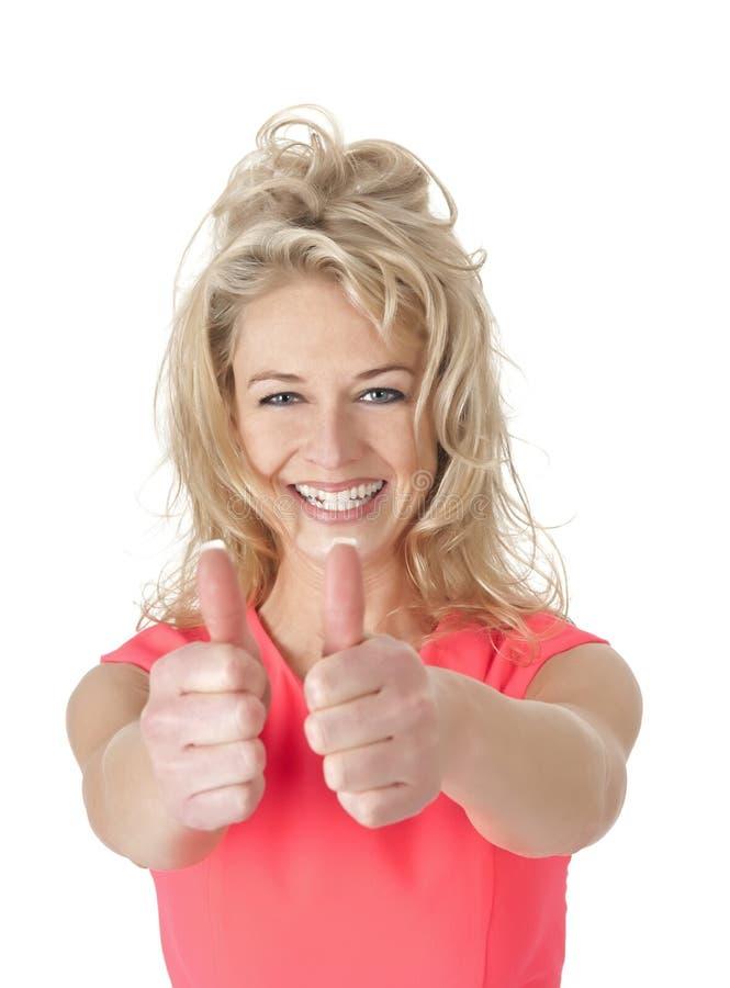 Femme heureuse montrant des pouces  image libre de droits