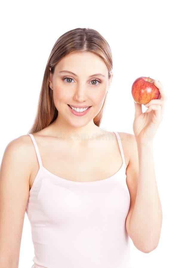 Femme heureuse tenant Apple photos libres de droits
