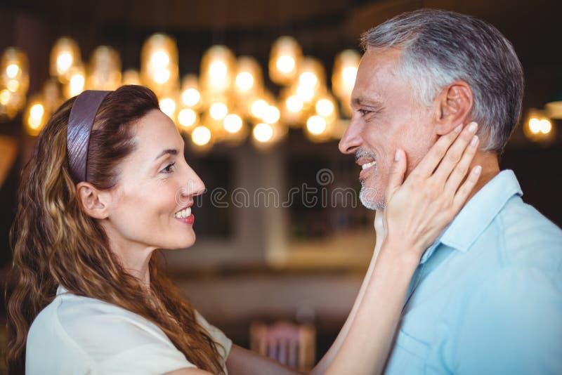 Download Femme Heureuse Touchant Son Mari Image stock - Image du brun, embrassement: 56487127