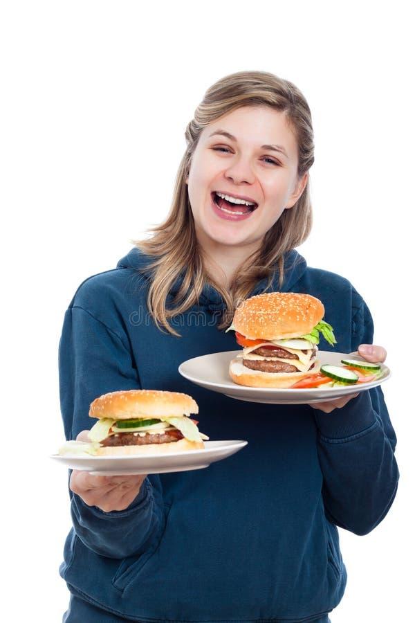 Femme heureux avec les hamburgers faits maison frais photographie stock libre de droits