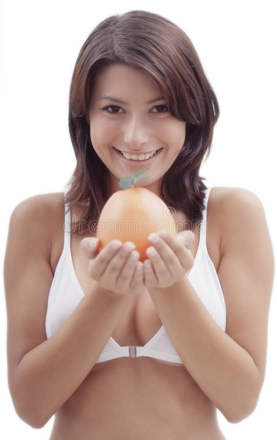 Femme heureux avec un fruit orange photo libre de droits