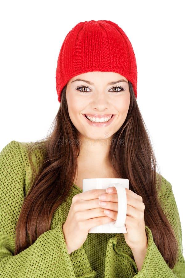 Femme heureux retenant une théière photo libre de droits