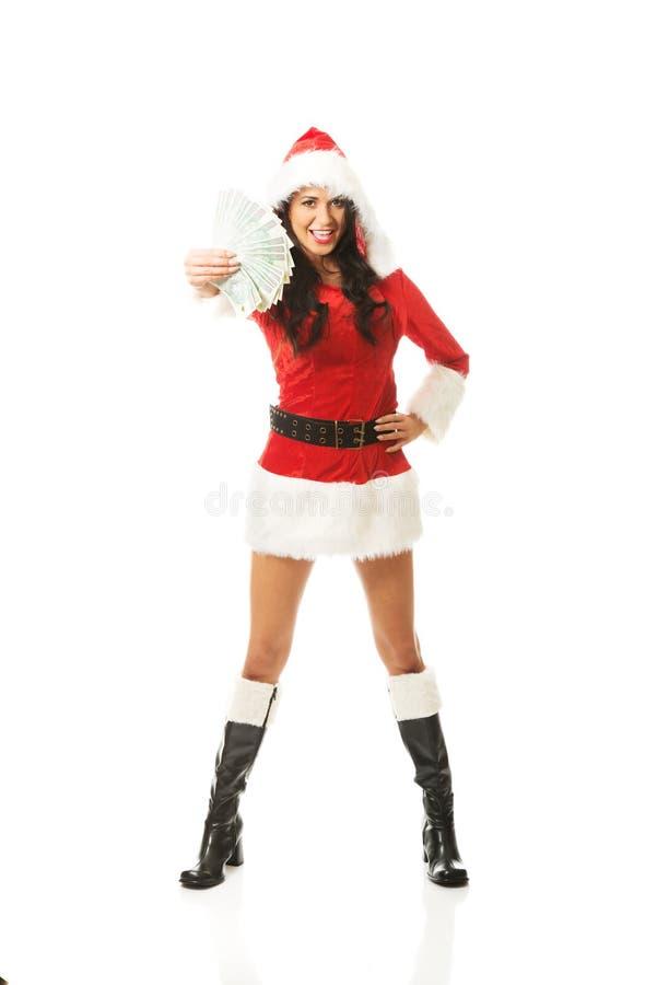 Femme intégrale de Santa tenant une agrafe d'argent polonais, se tenant à califourchon sur photos stock