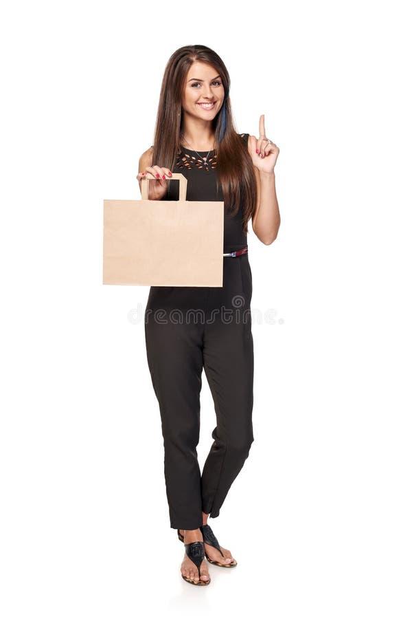 Femme intégrale tenant le panier brun de carton image libre de droits