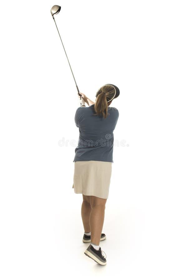 Femme jouant au golf images libres de droits