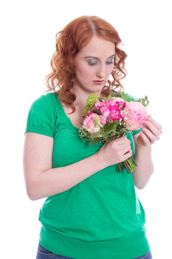 Femme malade d'amour en vert d'isolement sur le blanc photographie stock