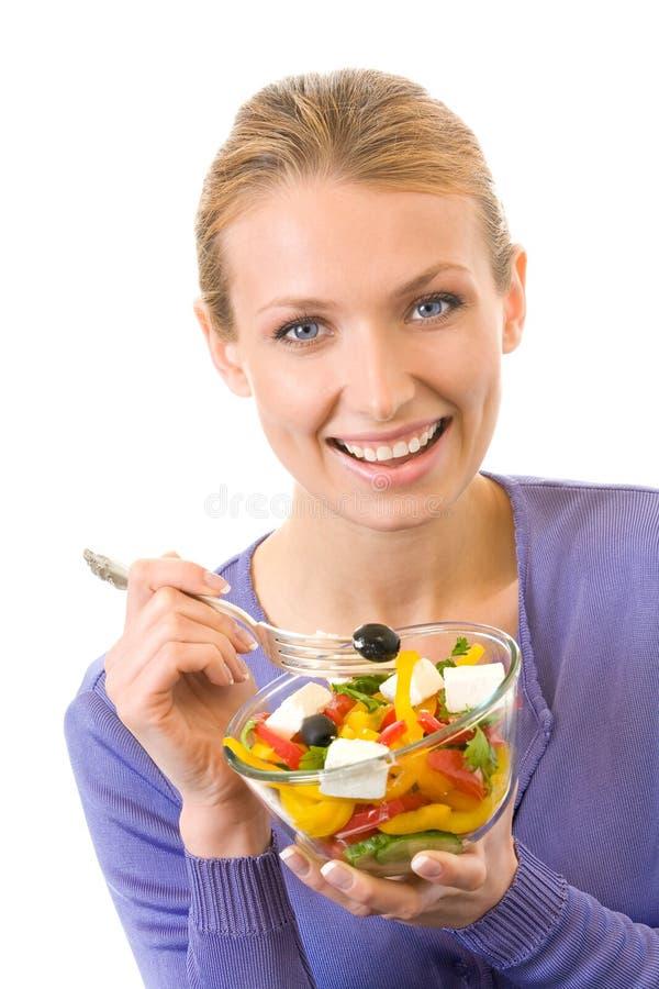 Femme mangeant de la salade, d'isolement photo libre de droits