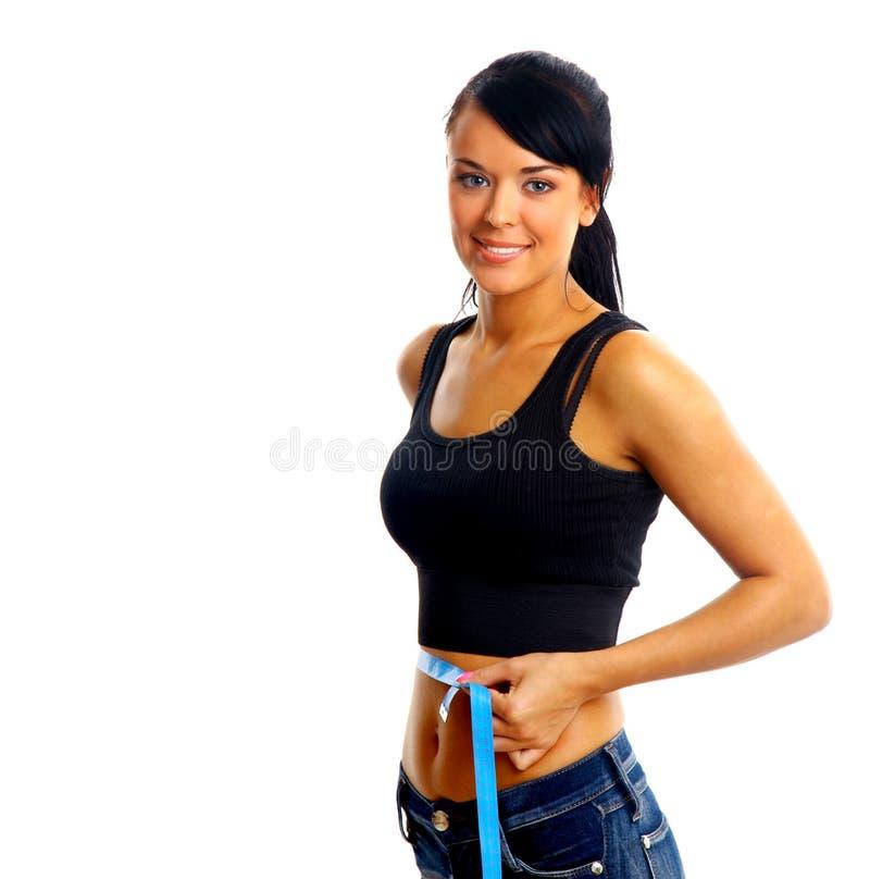 Femme mesurant la forme parfaite de la belle cuisse photos libres de droits