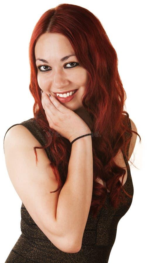 Femme mignonne avec la main sur le menton image stock