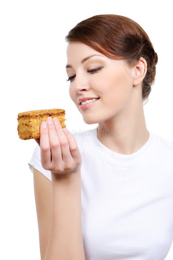 Femme mignonne mangeant le gâteau image libre de droits