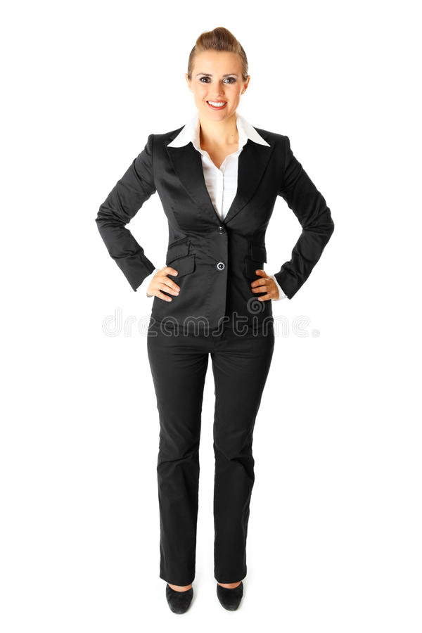 Femme moderne de sourire d'affaires avec des mains sur des gratte-culs photographie stock libre de droits