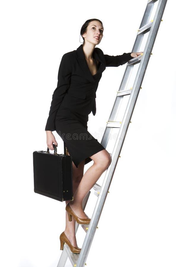 Femme Montant Une échelle Images stock