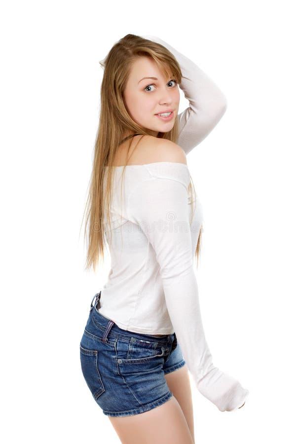 Femme montrant son épaule image stock