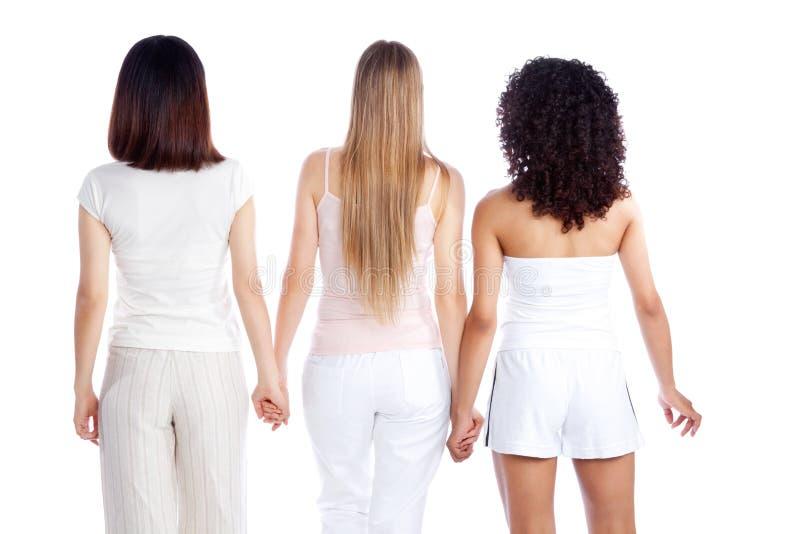 Femme multi-ethnique tenant la main image stock