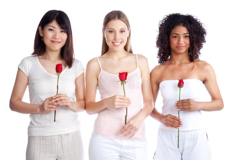 Femme multi-ethnique tenant Rose image libre de droits