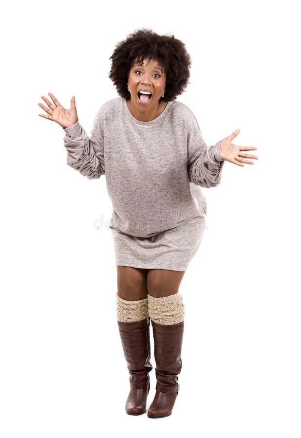 Femme occasionnelle noire sur le fond blanc images libres de droits
