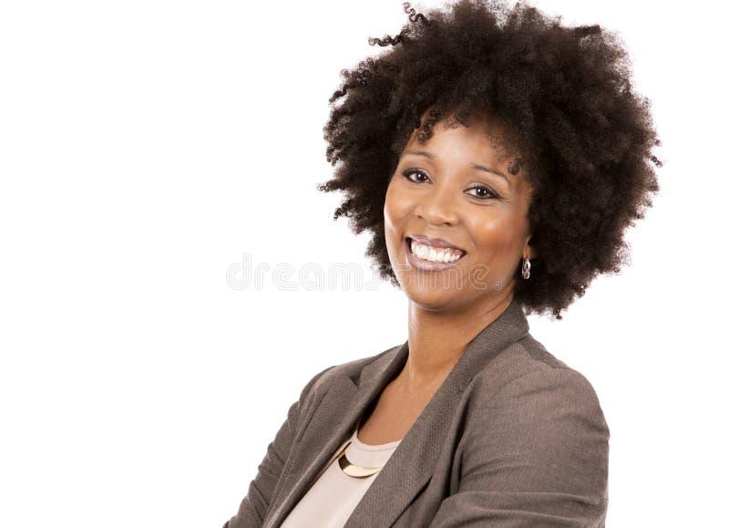 Femme occasionnelle noire sur le fond blanc photo stock