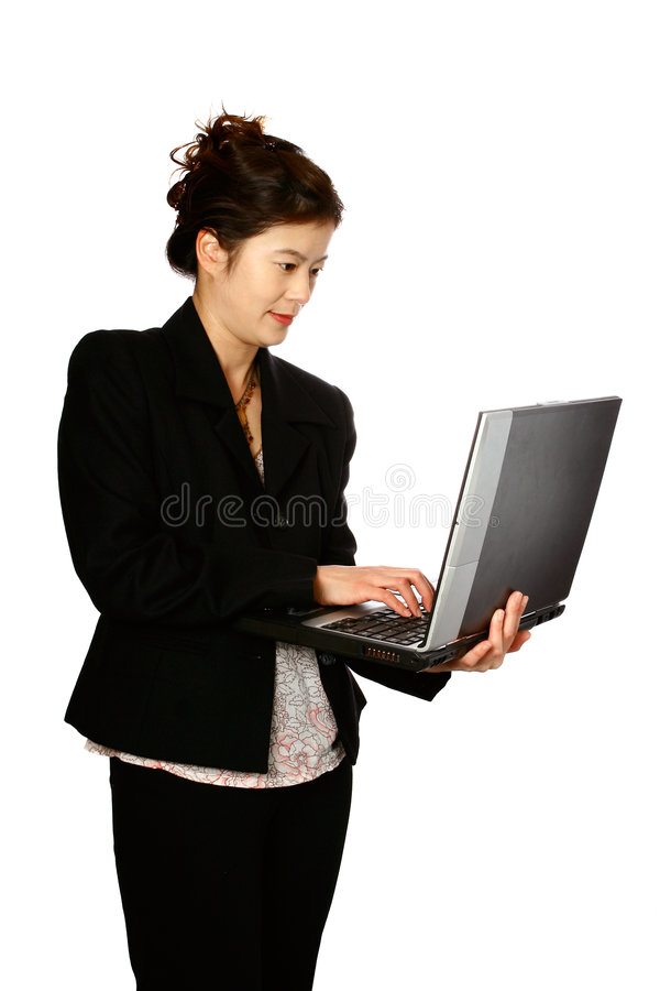Femme oriental avec l'ordinateur portatif images stock