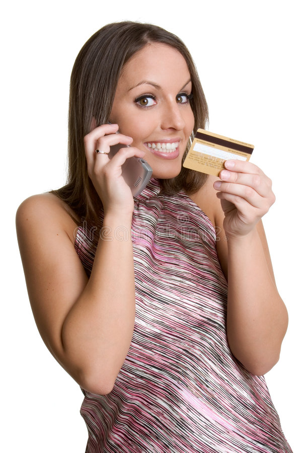 Femme par la carte de crédit de téléphone image stock