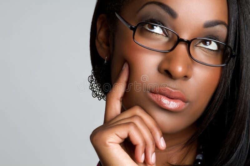 Femme pensant image stock