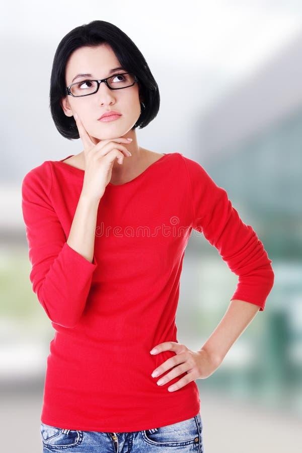 Femme pensive d'étudiant image libre de droits