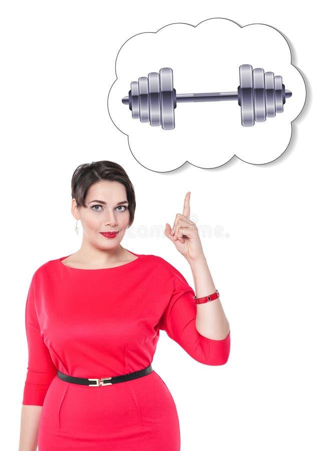 Femme plus de taille montrant sur la bannière avec l'haltère d'isolement photo stock