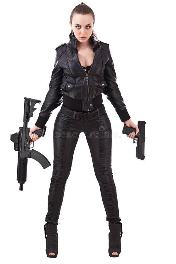 Femme posant avec des canons photos libres de droits