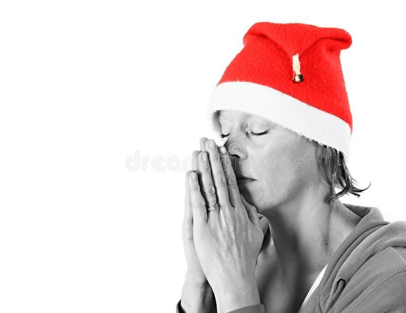 Femme priant avec des mains ensemble photographie stock libre de droits