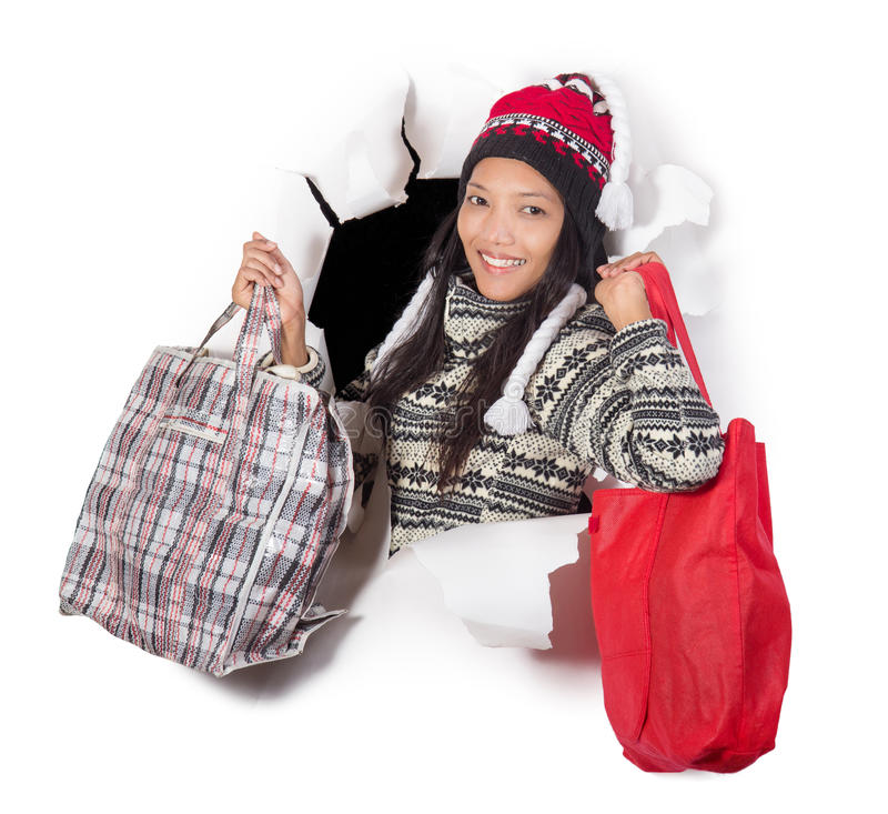 Femme retenant des sacs à provisions images libres de droits
