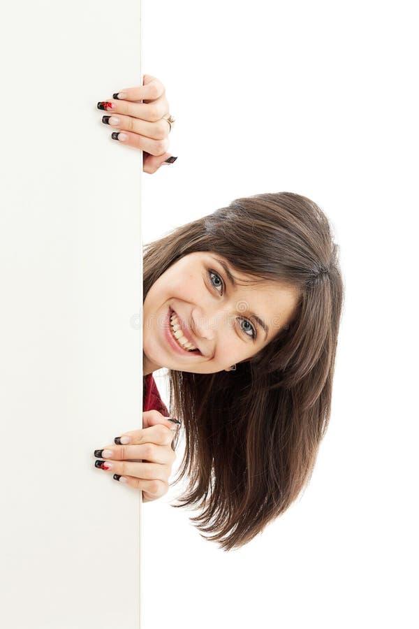 Femme retenant le panneau-réclame blanc images libres de droits