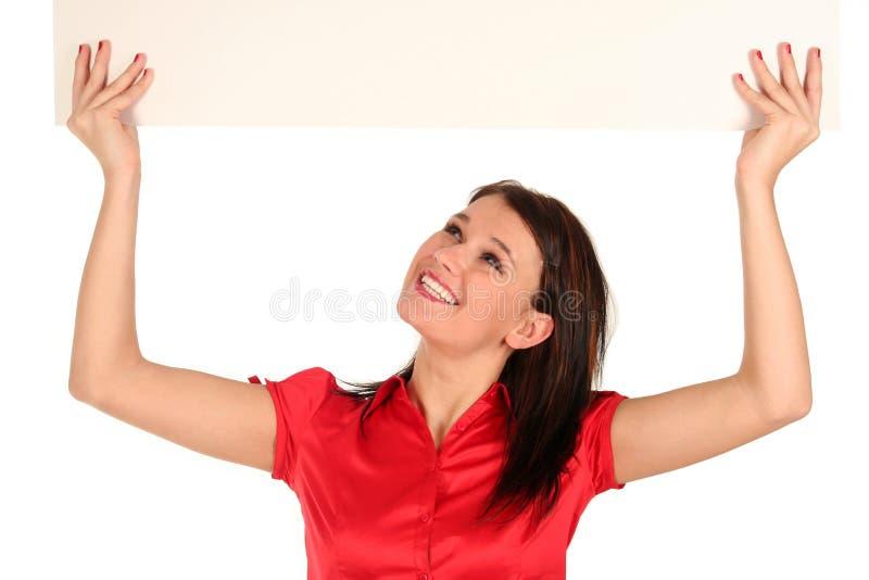Femme retenant le panneau-réclame blanc photos libres de droits