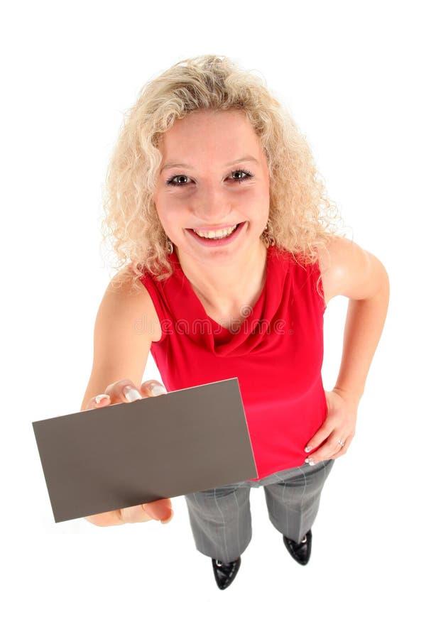 Femme retenant le signe blanc photographie stock libre de droits