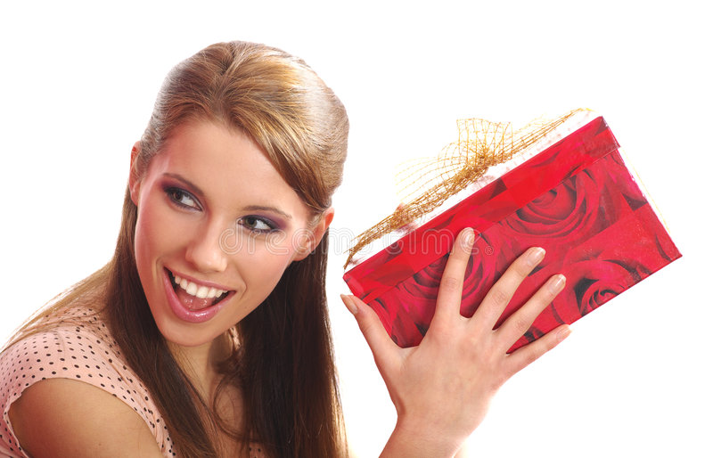 Femme retenant un cadre de cadeau photo stock