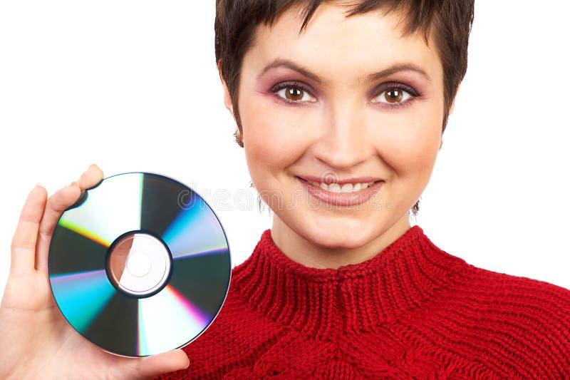 Femme retenant un Cd images stock