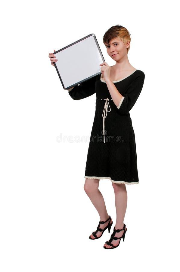 Femme retenant un signe blanc photos stock