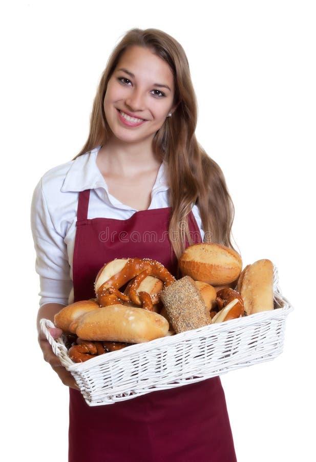 Femme riante avec des petits pains de pain de la boulangerie photos libres de droits