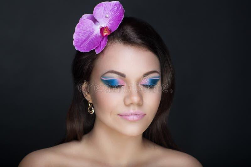 Femme rose intelligente d'orchidée images stock