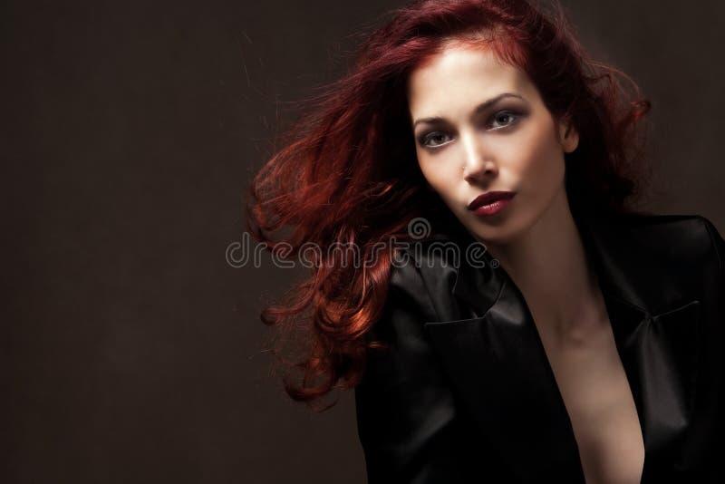 Femme rouge de cheveu photo stock
