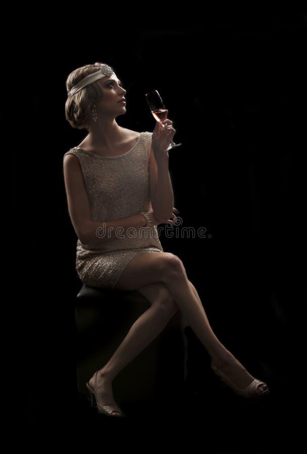 femme 20s avec le verre de champagne image libre de droits