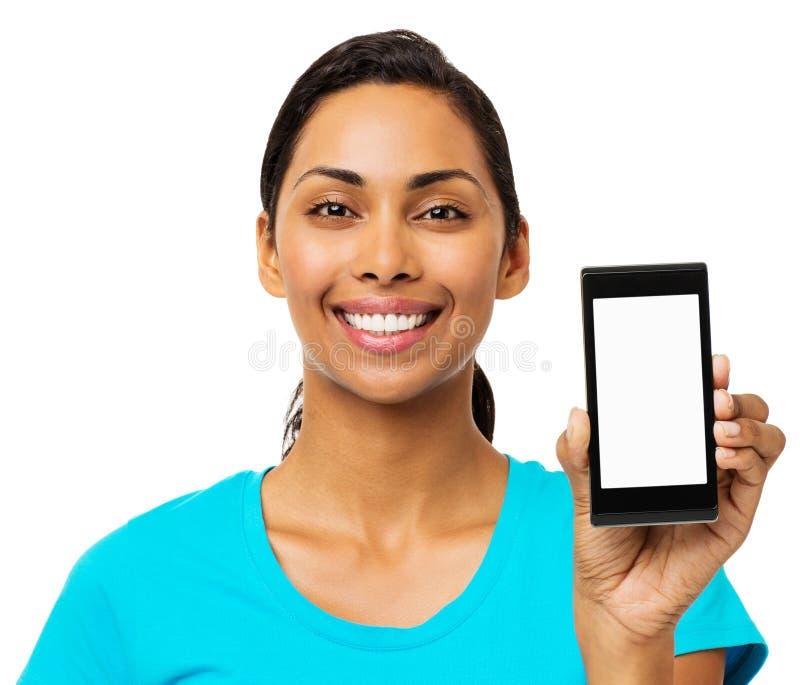 Femme sûre montrant le téléphone intelligent photo stock