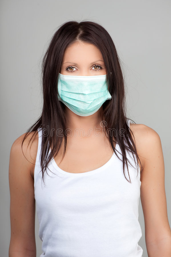 femme s'usante de masque protecteur photo libre de droits