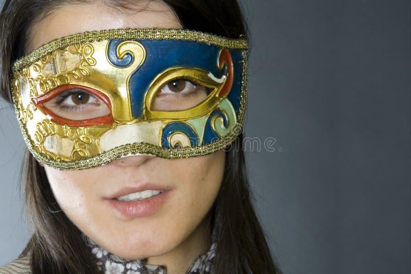 femme s'usante vénitienne de masque photographie stock