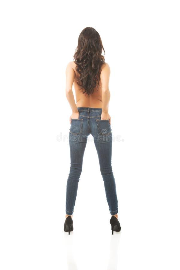 Femme sans chemise de vue arrière intégrale photographie stock