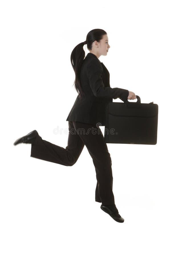 Femme sautante d'affaires image libre de droits